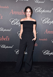 Nicole Warne completed her outfit with black wide-leg trousers.