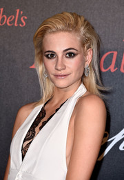Pixie Lott went for edgy styling with this slicked-back hairstyle at the Chopard Gent's Party.