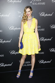Petra Nemcova's strappy blue heels provided a gorgeous contrast to her yellow frock.
