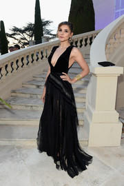 Clotilde Courau grabbed stares in a black gown with a plunging neckline at the Chopard Secret Night.