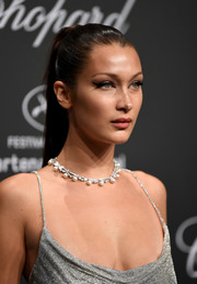 Bella Hadid paired a pearl necklace with a low-cut silver gown for the Chopard Space Party.
