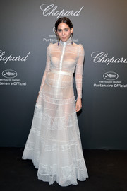 Araya Hargate didn't let her baby bump stop her from rocking the sheer trend at the Chopard Space Party. Her sweet-meets-sexy gown is by Ashi Studio.