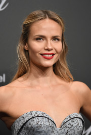 Natasha Poly opted for a demure half-up hairstyle when she attended the Chopard Space Party.