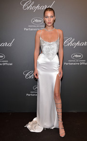 Bella Hadid ravished at the Chopard Space Party in a Roberto Cavalli Couture gown with a micro-beaded bodice, waist cutouts, and a high side slit.