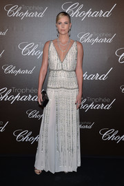 Charlize Theron paired her dress with a black box clutch, also by Prada.