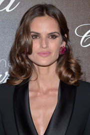 Izabel Goulart's huge Chopard studs added a welcome pop of color to her black tux.