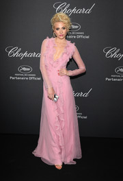 Pixie Lott went ultra girly in a pink ruffle gown by Blumarine for the Chopard Wild Party.