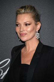 Kate Moss styled her hair into a pompadour for the Chopard Wild Party.