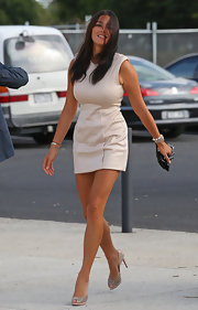 Jessica Gomes wore lovely stud-embellished nude pumps with a simple nude mini dress.