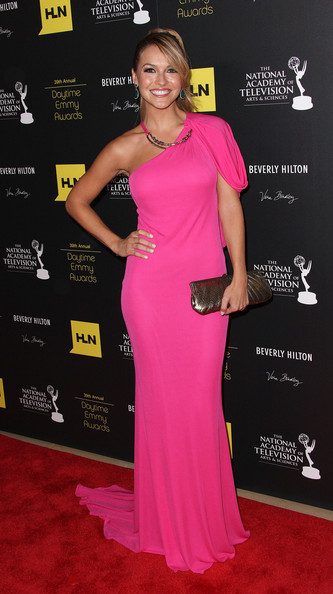 Chrishell Stause Metallic Clutch [flooring,pink,shoulder,carpet,magenta,joint,red carpet,gown,dress,cocktail dress,arrivals,chrishell stause,beverly hills,california,the beverly hilton hotel,daytime entertainment emmy awards]