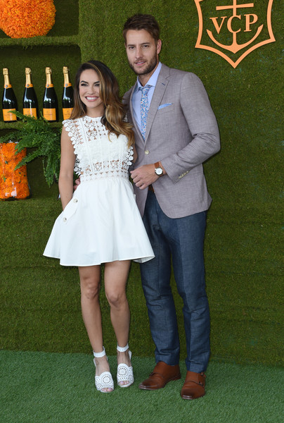 Chrishell Stause Mini Dress [photo,event,premiere,formal wear,dress,flooring,arrivals,chrishell stause,justin hartley,chris delmas,will rogers state historic park,pacific palisades,veuve clicquot polo classic]