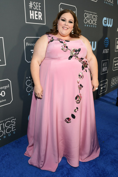 Chrissy Metz One Shoulder Dress [red carpet,clothing,red carpet,dress,shoulder,carpet,premiere,pink,gown,hairstyle,joint,carpet,chrissy metz,actor,critics choice awards,red carpet,fashion,clothing,barker hangar,santa monica,chrissy metz,24th critics choice awards,this is us,the barker hangar,film awards seasons,red carpet,actor,fashion,screen actors guild awards]