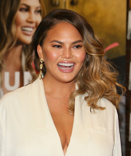 Chrissy Teigen Gold Dangle Earrings [book,cravings: hungry for more,book,hair,face,hairstyle,eyebrow,lip,beauty,skin,long hair,chin,brown hair,chrissy teigen,chrissy teigen signs,copies,california,los angeles,chrissy teigen,vilailuck teigen,cravings: hungry for more,stock photography,photography,getty images,photograph,celebrity,image]