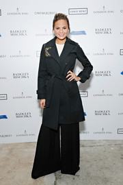 Chrissy Teigen looked classic and stylish in an embellished black trenchcoat during the London Fog celebration.