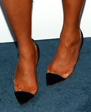 Chrissy kept her look simple and chic with black pointy-toe pumps that featured a clear plastic base.