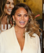 Chrissy Teigen sealed off her look with a pair of gold dangle earrings by Marco Bicego.