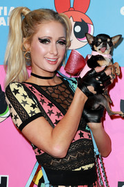 Paris Hilton rocked a pair of fingerless leather gloves at the Christian Cowan x The Powerpuff Girls show,