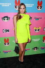 Christa B. Allen brightened up the black carpet with this asymmetrical neon-yellow dress at the Christian Cowan x The Powerpuff Girls show.