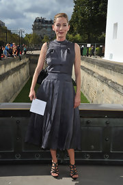 Lucia was serene in her gray pleated day dress dress at the Dior show in Paris.