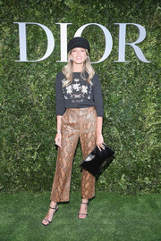 Helena Bordon rounded out her ensemble with a simple black leather clutch by Dior.