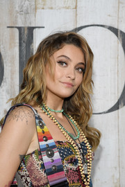 Paris Jackson wore her hair down in piecey waves at the Dior Cruise 2019 show.