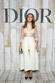 A pair of cream-colored shorts with a skirt overlay finished off Olivia Cooke's outfit.