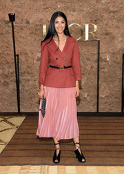 Caroline Issa was business-chic in a double-breasted coral blazer by Dior during the brand's Cruise 2020 show.