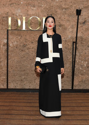 Nicole Warne paired her frock with a black velvet clutch, also by Dior.
