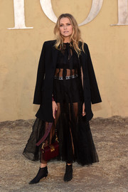 Teresa Palmer toned down the sexiness with a black wool coat.