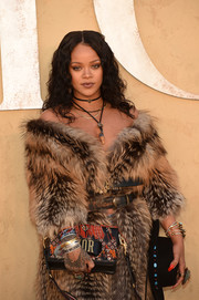 Between the beaded purse, the fur coat, and the bling, Rihanna was a real standout at the Christian Dior Cruise 2018 show!