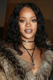 Rihanna attended the Christian Dior Cruise 2018 show wearing a center-parted curly 'do.