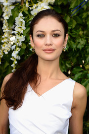 Olga Kurylenko was fresh-faced at the Christian Dior fashion show with this casual ponytail.