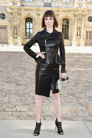Coco Rocha was moto-chic in a black leather skirt suit during the Dior fashion show.