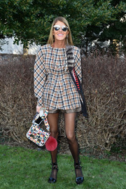 Anna dello Russo pulled off clashing patterns with this geometric-print bag and checkered outfit combo.