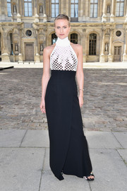 Olympia Scarry donned a curve-hugging, mochrome halter dress by Christian Dior for the label's fashion show.