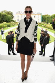 Olivia Palermo was moto-chic in a black-and-white leather vest by Christian Dior during the label's fashion show.