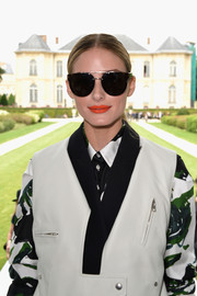 Olivia Palermo's beauty look totally popped with this bright coral lip color.