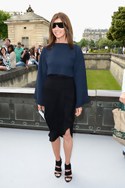 Carine Roitfeld wore this long-sleeve blue and black dress at the Christian Dior Haute Couture show.