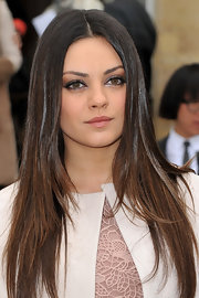Mila Kunis created her smoky-eyed effect with rich brown shades of shadow at the Christian Dior fall 2012 fashion show.
