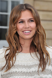 Dasha Zhukova wore her layered cut in softly mussed waves at the Christian Dior 2012 fall fashion show.