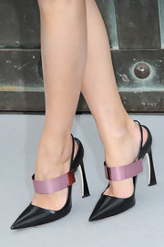 Olivia's heels at the Christian Dior fashion show were absurdly fabulous.
