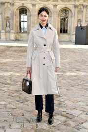 Caroline Issa kept warm with a cream-colored trenchcoat as she arrived for the Christian Dior fashion show.