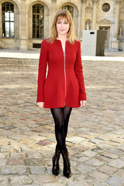 Marie-Josee Croze opted for a red zip-up coat dress when she attended the Christian Dior fashion show.