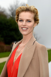 Eva Herzigova wore her short hair casually brushed back from her face during the Dior Couture show.