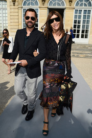 A mixed-print fluted-hem skirt gave Carine Roitfeld's look a dose of femininity.