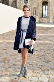 Helena Bordon punched up her look with fierce gray mid-calf boots, also by Dior.