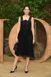 Laetitia Casta looked chic in a little black dress with a fringed skirt at the Dior Spring 2020 show.