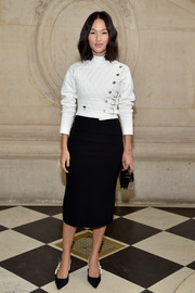 Nicole Warne teamed her jacket with a plain black pencil skirt.