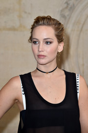 Jennifer Lawrence pulled her locks back into a messy updo for the Christian Dior fashion show.