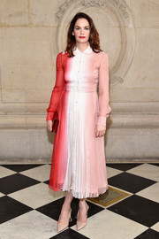 Ruth Wilson looked adorable in a ribbed ombre shirtdress by Dior while attending the label's fashion show.